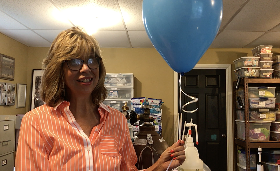 Peggy Williams Demonstrates How to Inflate a Latex Balloon